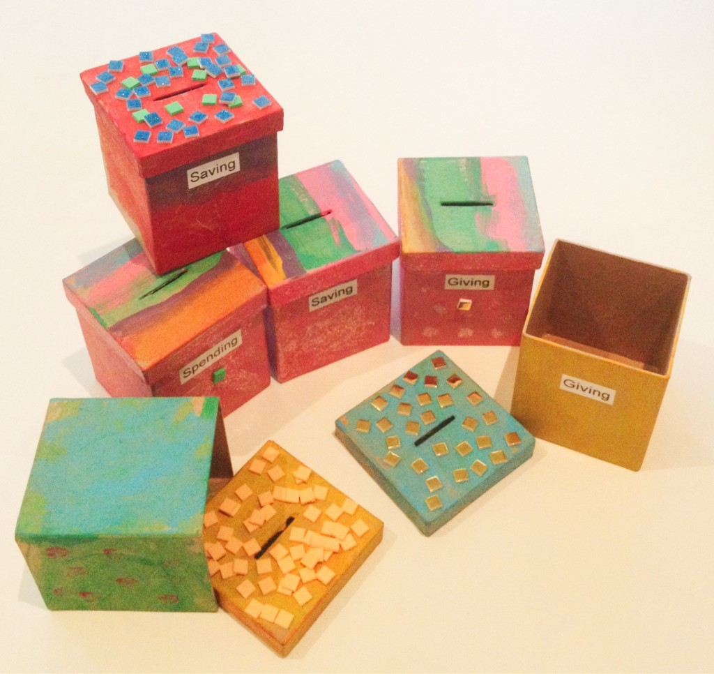 Money boxes - spending saving and giving