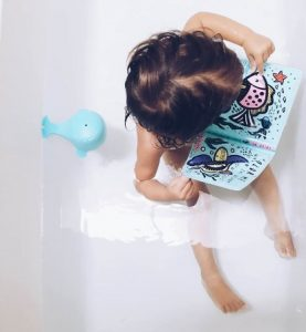 One year old gift ideas - colour me bath book in the bath